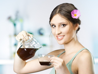 beautiful happy young woman drinking tea at home in the morning