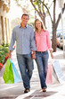 Couple carrying shopping
