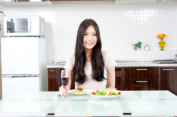 attractive asian woman on the kitchen
