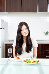 attractive asian woman in the kitchen