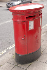 A British Oval Red Post Box designed for two classes of mail