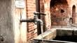 Brunnen, Wasserhahn