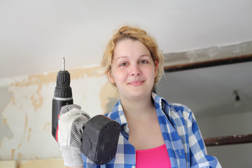 Young worker with drill
