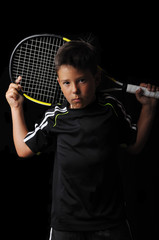 Tennis boy isolated in black