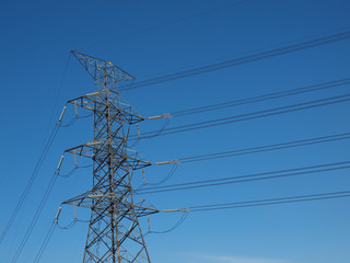High power electricity post with cables in blue sky