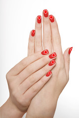 Manicured Red Nails with Heart Motif