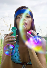 woman blowing soap bubble