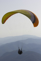 Paraglider above alpine mountains