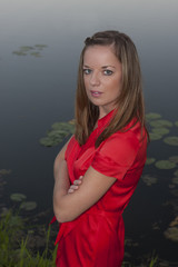 Girl in red by the pond