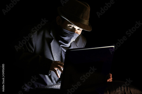 Masked man stealing sensitive information