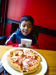 Asian boy and pizza