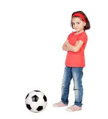 Brunette little girl with a soccer ball