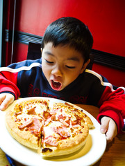 Asian Boy ready to eat a pizza