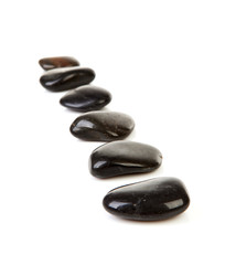 Black stepping stones in a row over white background