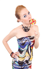 Woman biting lollipop