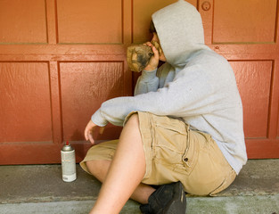 teen boy huffing - sniffing paint