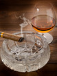 cuban  cigar over ash tray and cognac