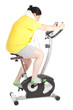 overweight woman on stationary fitness bicycle, series