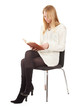 reading young woman with book sitting on chair