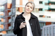 portrait of young businesswoman with a mobile
