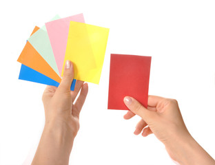 Multi-colored cards in hands