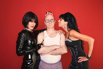 Man with Dominatrix Women