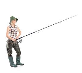 Smiling fisherwoman holding a fishing pole
