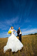 Beautiful couple on the yellow field