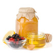 glass jar full of honey, lemon and berry