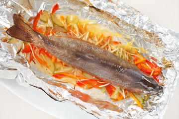 Trout baked with vegetables in the foil
