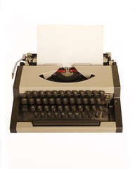 Typewriter isolated on white with a black piece of paper