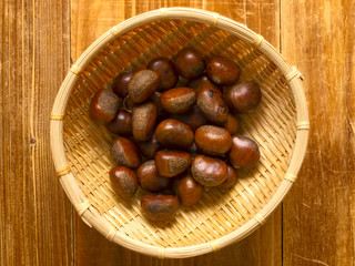 close up of a basket of roasted chestnuts