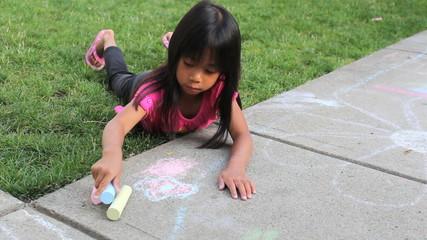 Little Girl Creating Sidewalk Art