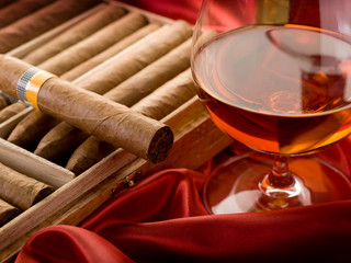 cuban cigar and  liquor  over red satin