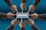 A diverse business team with hands together push Support button