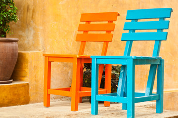two colorful chairs in the garden
