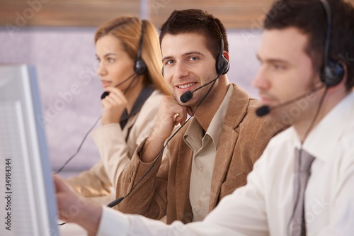 Cheerful young male dispatcher working