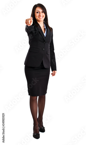 Smiling businesswoman pointing at you