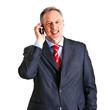 Mature businessman talking at the phone