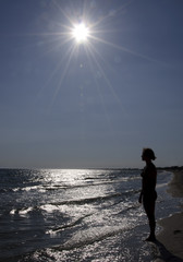 Silhouette of a girl in the beach