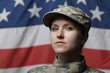Female soldier in front of US flag