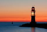 Leuchtturm bei Sonnenuntergang, Hafeneinfahrt Warnemünde