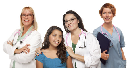 Hispanic Female Doctor with Child Patient and Colleagues Behind