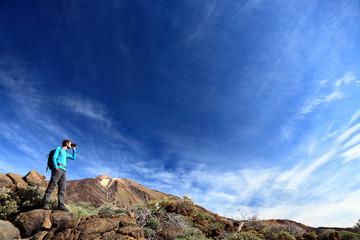 hiker in dramatic landscape