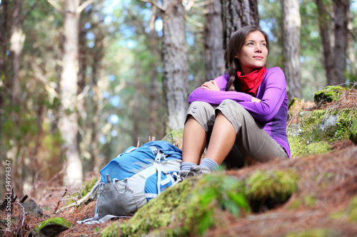 Person hiking - woman hiker sitting in forest