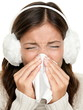 Flu winter sick woman sneezing of cold