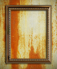 Gold frame on rust metal background