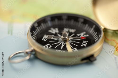 Leinwandbild Motiv Gold compass & map