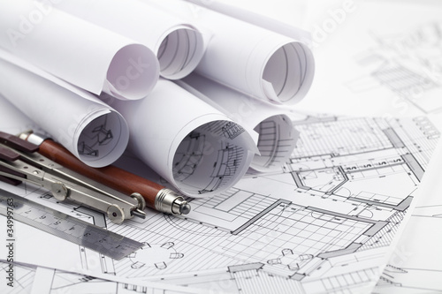 rolls of architecture blueprint & work tools - ruler, pencil