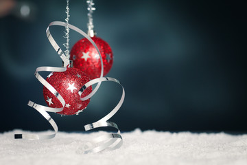 red christmas balls in front of bluish background
